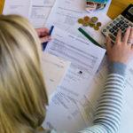 Women calculating bills